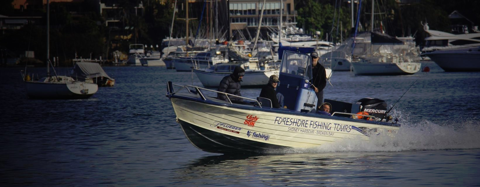 Foreshore fishing charters boat crusing Sydney Harbour
